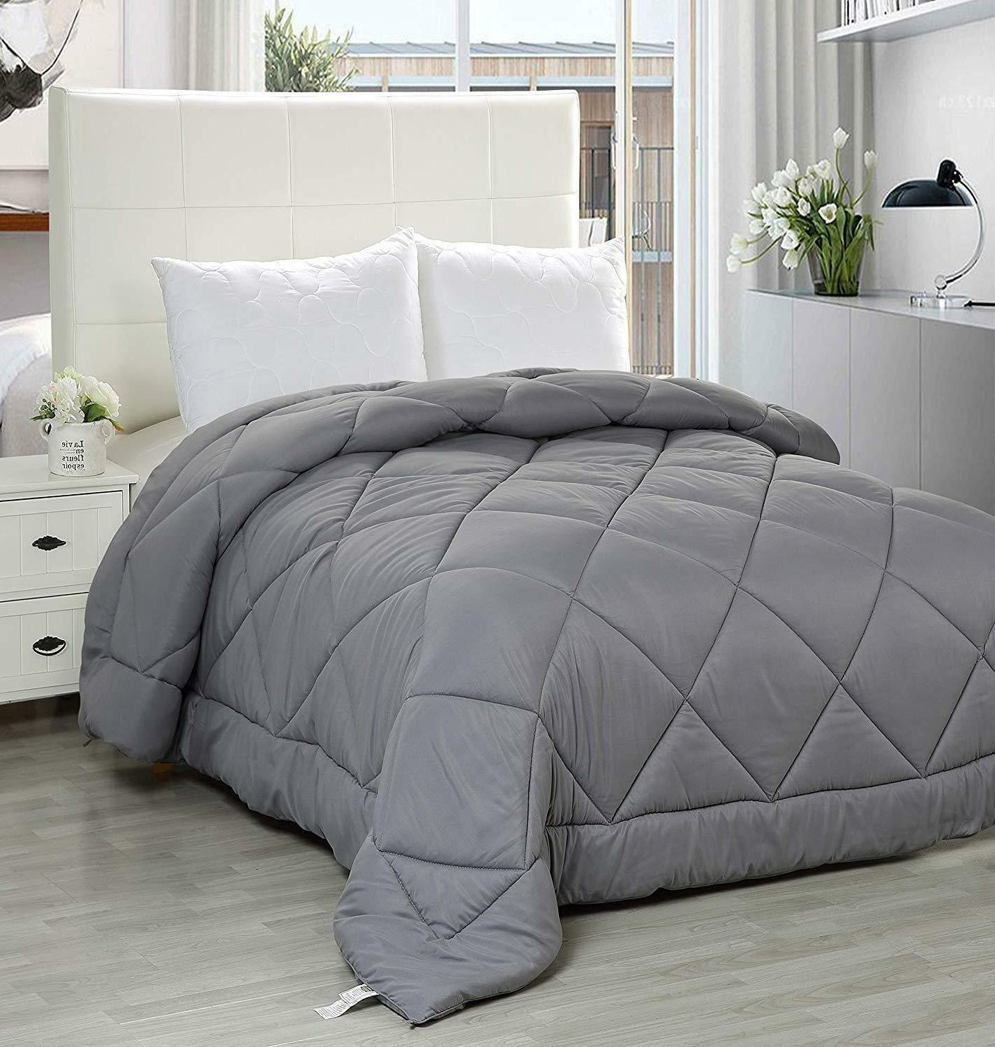 quilted comforter with corner tabs plush siliconized